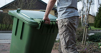 Man putting out the wheeley bins